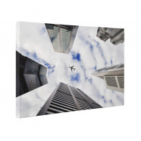 Plane Flying over Skyscrapers Box Canvas Print Wall Art - Choice of Sizes